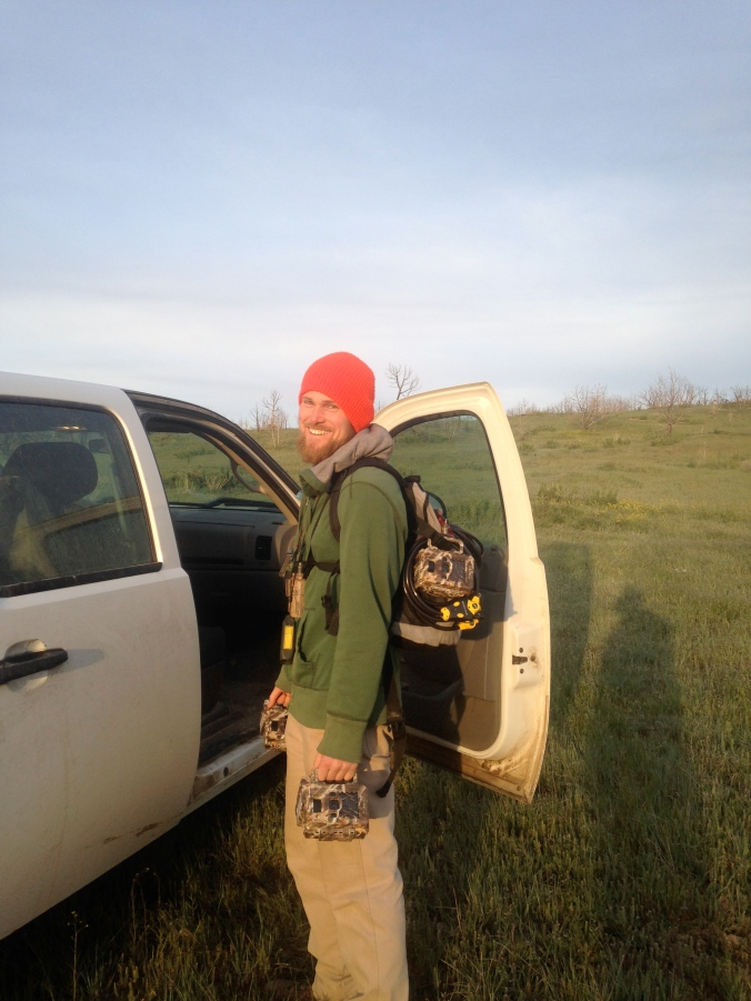 Our field technician, Aaron, loading up cameras to schlep out to their sites