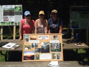Amanda, Sarah and Catherine at the QUBS open house with their poster board