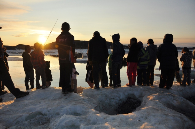 Cape Dorset youth at sunset.