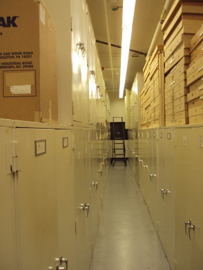 hallway of drawers filled with bird specimens