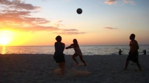 volleyball on the beach during the sunset