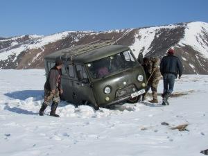 van stuck in the snow