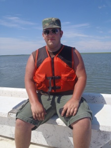Scott on a boat