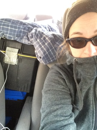 Sarah dressed in a toque and sweater with eggs in boxes in the car.