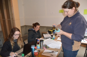 Preparing for release: (left to right) Leanne, Lia, and Lauren banding and assessing owls for release.